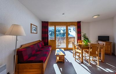 Photo for Family Mountain Escape in Rustic Apartment with 100km of Ski Slopes!