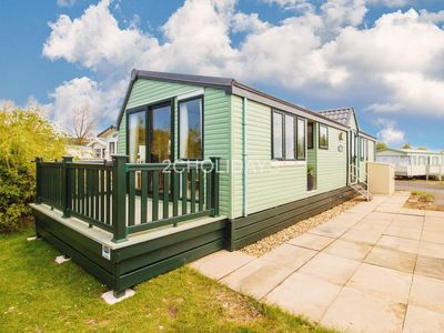 Photo for Luxury caravan with decking and stunning lake view for hire ref 33002