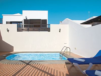 Photo for Modern villa w/ air con, free Wi-Fi + BBQ, walking distance from shops