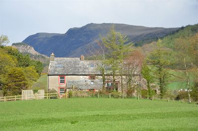 Hallflat Farm with Whin Rigg backdrop, farmhouse on left.