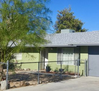 Sage green house and new roof! Pull into driveway and roll your stuff in!