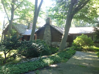 Real log house on Directly on the River with heated pool one hour from NYC.