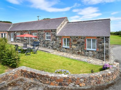 Photo for One of four holiday homes on Bwlch Farm, Y Stabl is a fabulous stone stable conversion retaining ori