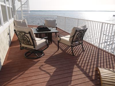 One portion of third floor deck with fit pit and staircase up to sun deck