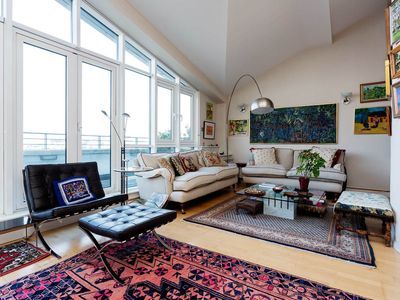 Photo for Stylish apartment sleeping 4 with beautiful river views, Battersea (Veeve)