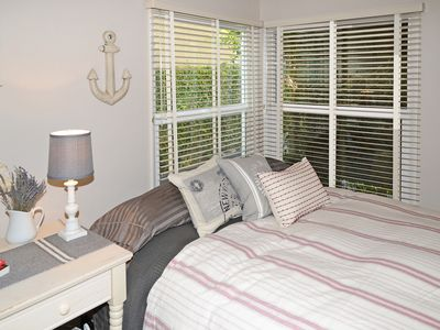 both bedrooms have corner windows with light and sunshine streaming through