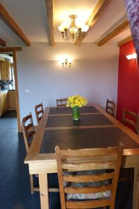 Lovely oak and slate dining table with chairs in Wagon House