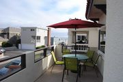 Lovely newly-remodeled upper unit with amazing balcony for grilling & chilling
