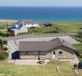 Photo for Very comfortable, well-equipped, 4 bedroomed holiday house overlooking the beach