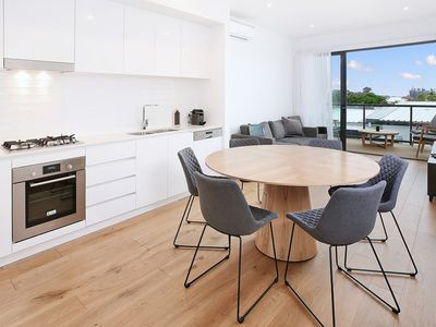 Photo for Split-Level Executive 3BR Townhouse-style Apartment with Views of the CBD