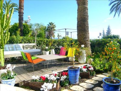Photo for Exceptional Sea-Front design Condo, Private Garden across from Beach!