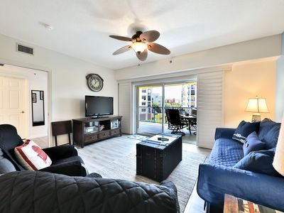 Photo for Waterfront getaway w/  balcony, shared pools/hot tub, tennis, & beach access