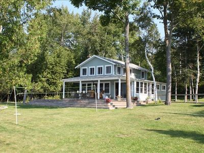 Photo for Beautiful lake front family home on the east side of Torch Lake