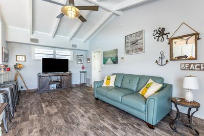 Driftwood flooring and coastal decor usher in relaxation and comfort.