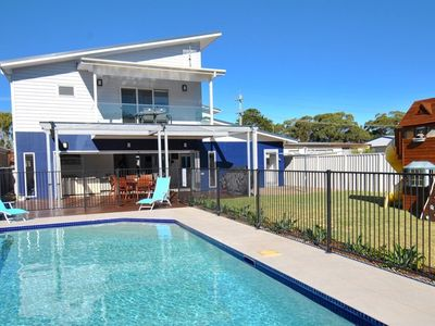 Photo for BEACH KING family home with a wonderful pool and cubby house close to beach