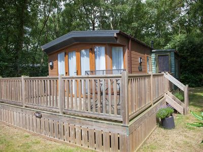 Photo for A beautifully presented holiday lodge with a spacious decked veranda, set amongst 300 acres of woodl