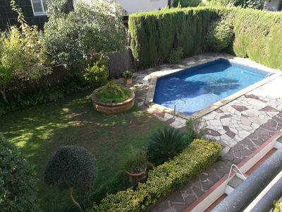 Photo for Cozy apartment with garden and pool for 4 people
