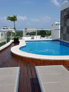 Photo for Cozy Apartment at Playa del Carmen with rooftop pool and elevator close to beach