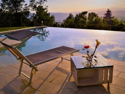 Photo for Tuscan villa with infinity salt pool and heated jacuzzi on breathtaking view