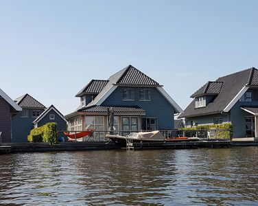 Photo for 10 persons luxury villa with a private dock at the Sneekermeer.