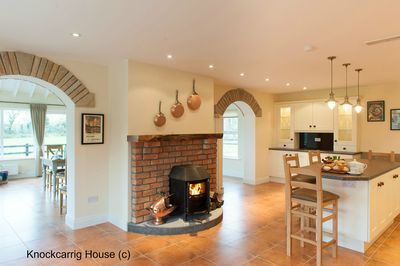 A burning log stove sets the mood in the kitchen!