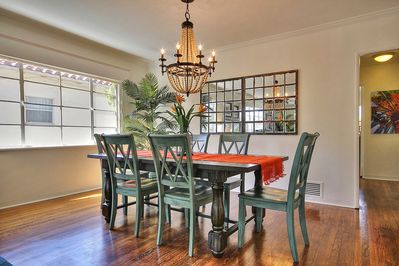 Dining area with open seating in living room, additional breakfast nook in kitchen