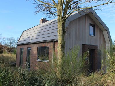 Photo for A brand new, beautiful family house with sauna. It is located in the dunes and only 1,5 km away from