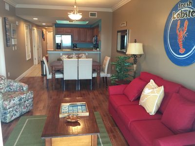Living area with tiled floors through out the condo!