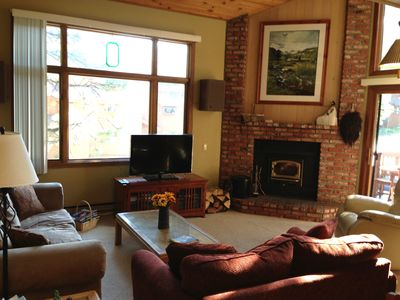 Livingroom with wood burning stove and 40' flat panel TV