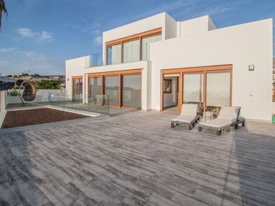 Photo for Fabulous contemporary 5 bedroom villa with private heated pool, sleeps max 13