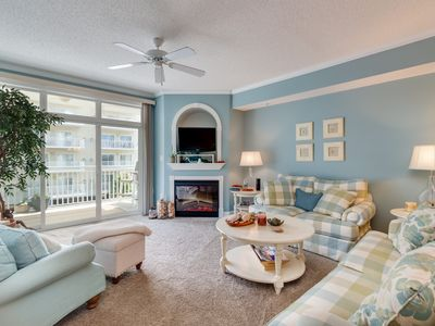 Photo for NEW LISTING! Breezy condo w/shared rooftop pool & gym moments from the beach