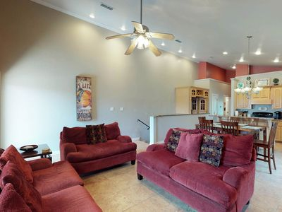Photo for Spacious condo w/ balcony firework show- steps from the beach!