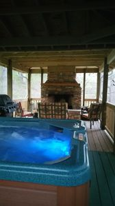 """Outdoor fireplace can be seen from hot tub. Things that make you go """"aaaahh""""."""