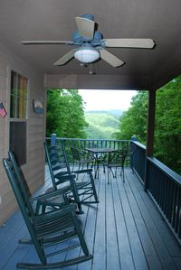 Covered rocking chair porch with great views in multiple directions