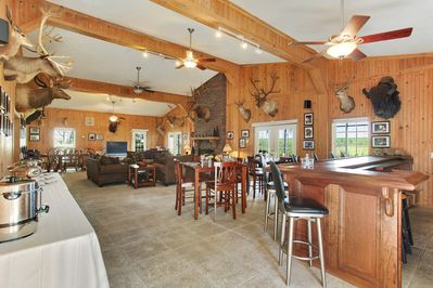 Great Room with Living, Dining, and Custom Built-In Teak Bar