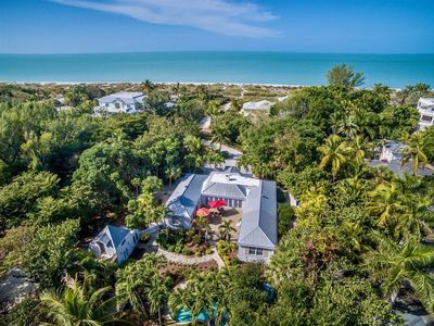 Photo for Beach access and boat dock. Private unique beach cottage style vacation rental home