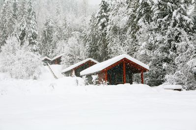 snow blanketed cabins