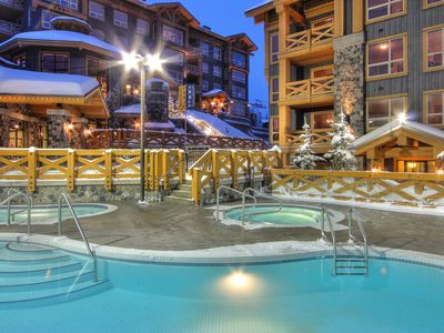 Photo for Ski-In Condo with a Balcony with a BBQ and PRIVATE Hot Tub | Gym Access