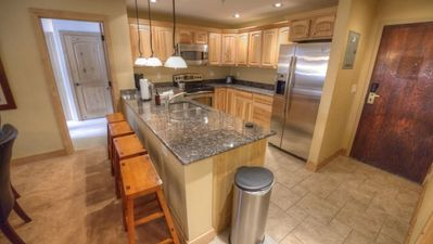 Newly remodeled kitchen with granite counters and stainless steel appliances.
