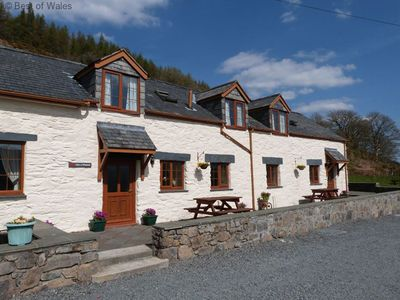 Photo for This cosy cottage is situated in a beautiful elevated position above the village of Penmachno, with