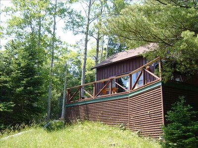 Front of Acadia Cove Cabin with deck overlooking Somes Sound