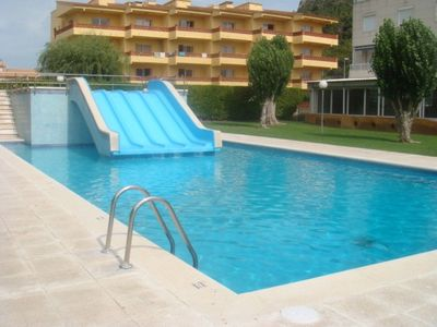 Photo for Apartment overlooking the garden and pool 450m from the beach