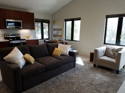 Full size sofa with pull out bed and comfy chair in living room