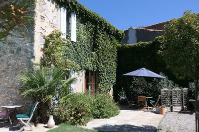 Very sheltered and sunny terrace with outdoor dining area and BBQ.