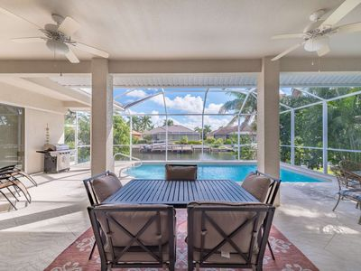 Photo for Fam/Pet Friendly Waterfront Home w/WiFi ~Heated Pool, Screened Lanai; Close to Beach, Shops/Dining