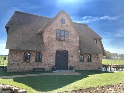 Photo for newly built thatched cottage with sauna and e-station for cars and bicycles