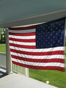 Our American Flag waves in the breeze on the porch
