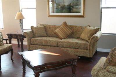The living room is well appointed and bright. The house has total 29 windows!