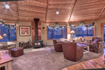 Warm cedar ceiling adds to the ambiance. Along with sunny meadow and tree views.
