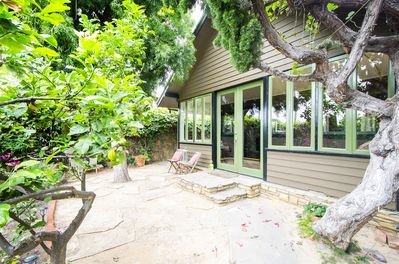 Front of Cottage with private sitting area. One block to Beach!